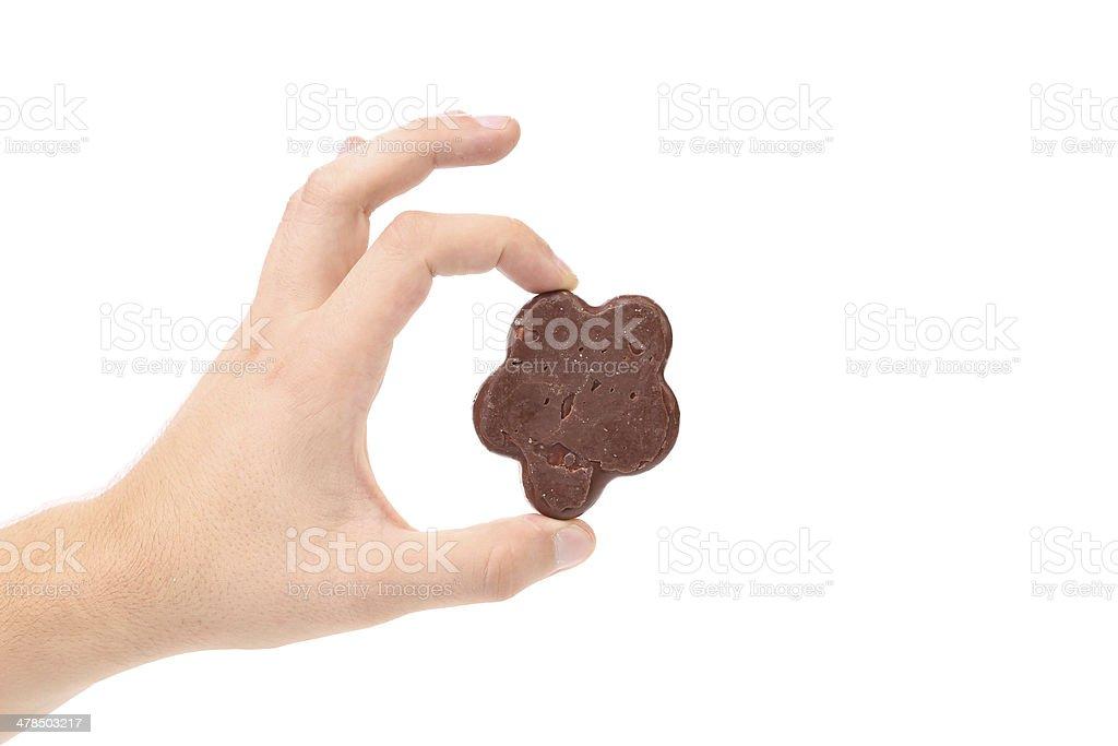 Hand holds chocolate meringues stock photo
