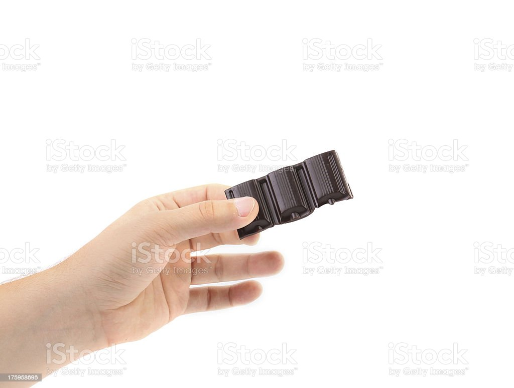 Hand holds dark chocolate bar. royalty-free stock photo