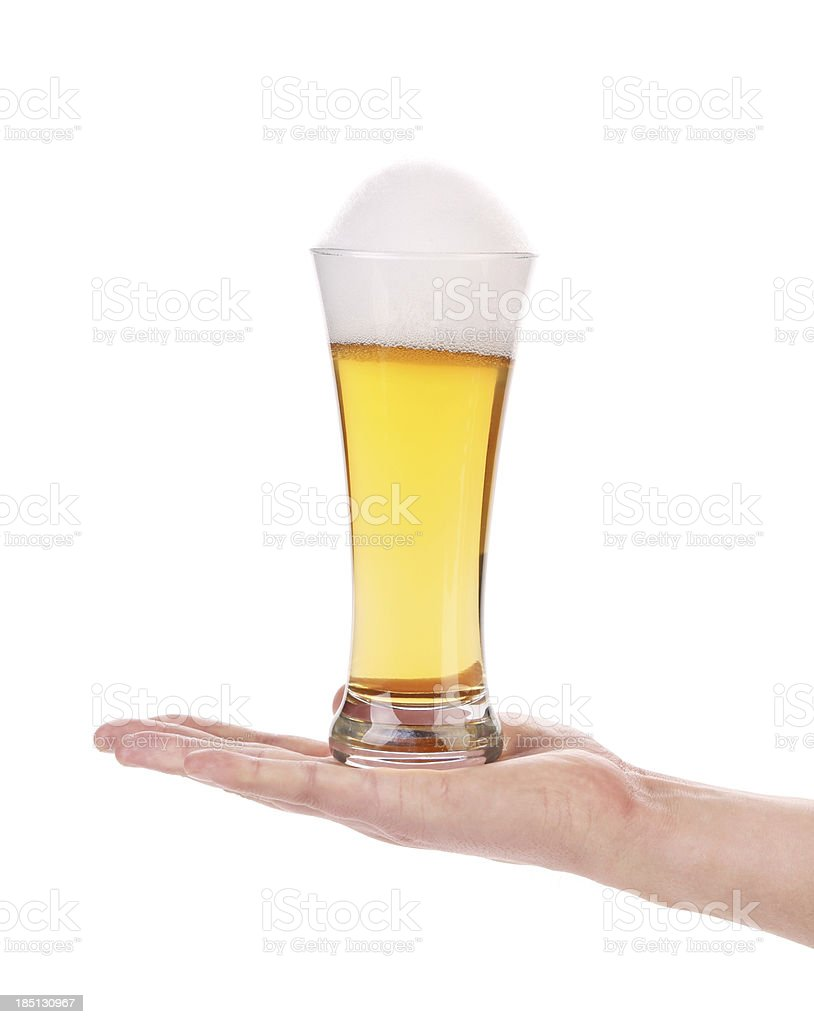 Hand holds glass of beer with foam. royalty-free stock photo