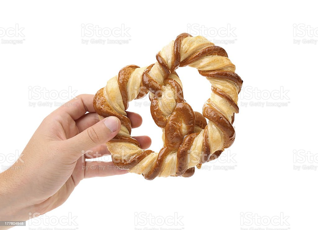 Hand holds knot-shaped biscuits royalty-free stock photo