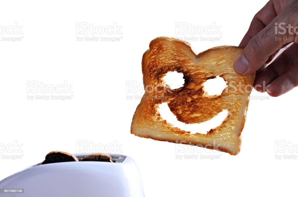 Hand holds one slices of toast bread stock photo
