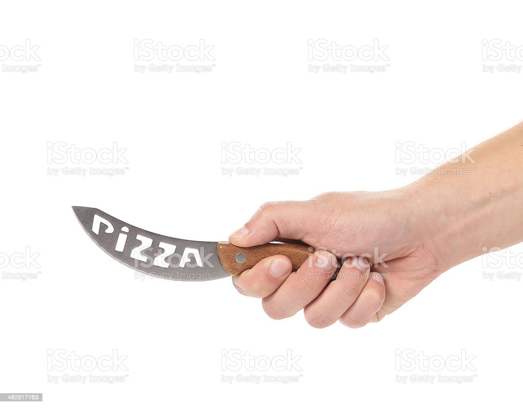 Hand holds pizza's knife. stock photo