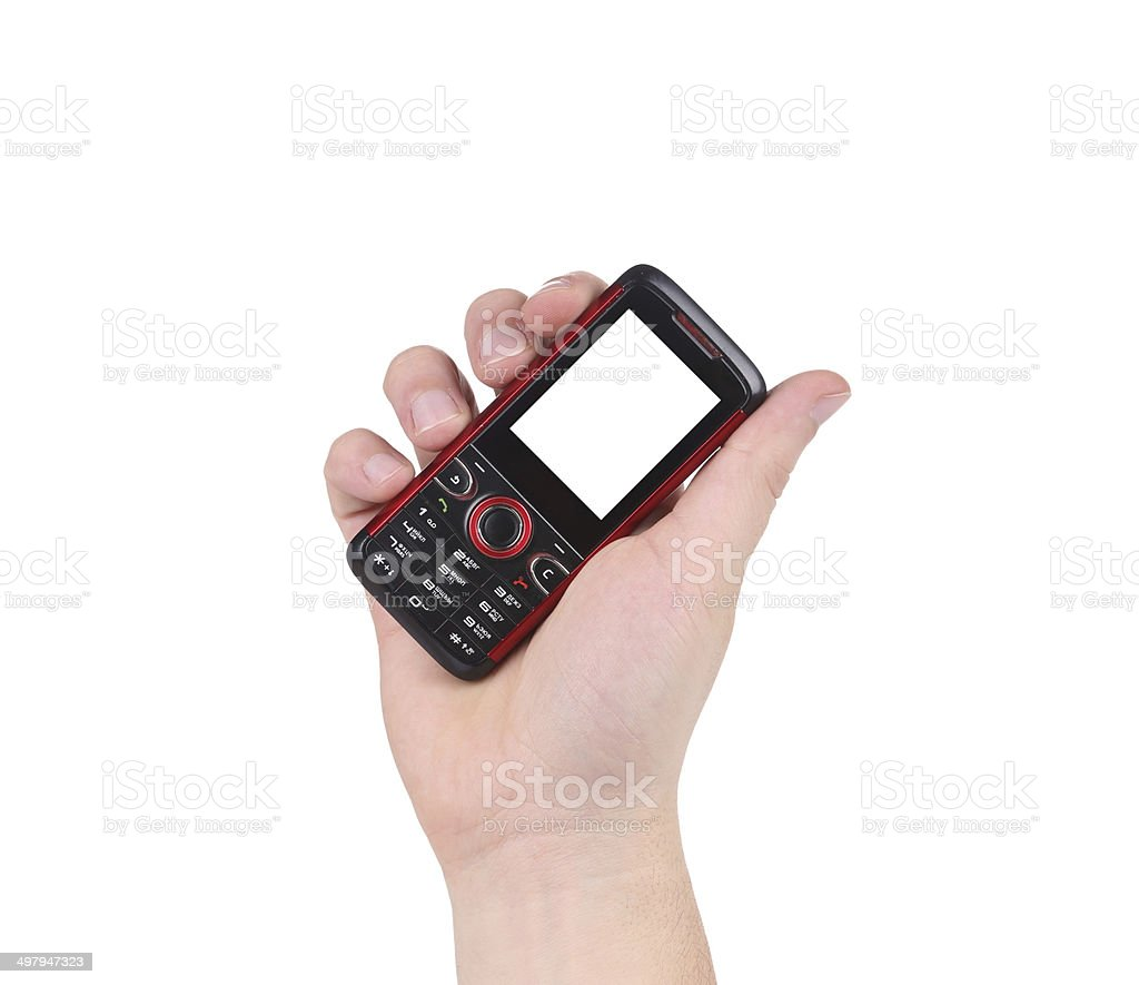 Hand holds red-black cell phone. stock photo