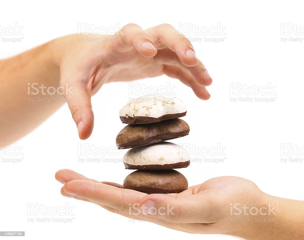 Hand holds stack of chocolate meringues. stock photo