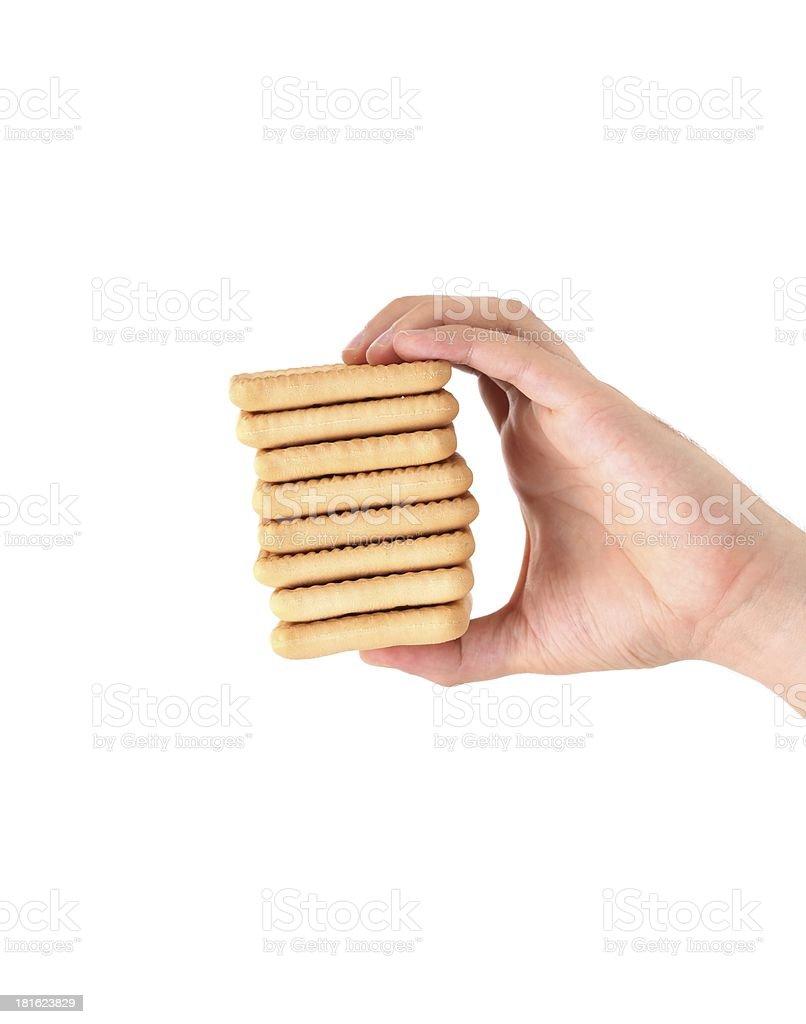 Hand holds stake saltine soda cracker. royalty-free stock photo