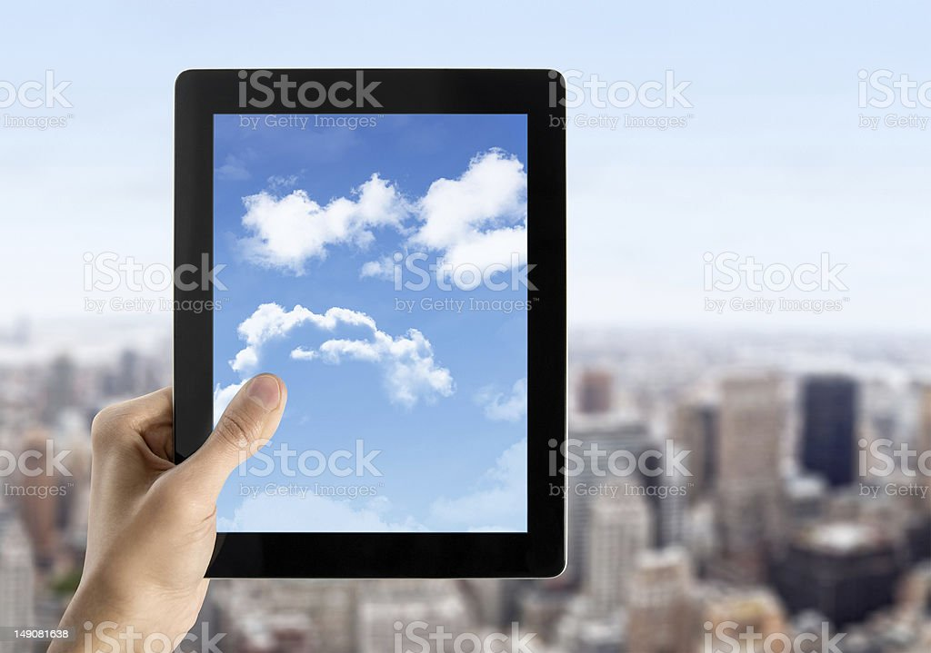 Hand Holds Tablet PC With Sky On Screen royalty-free stock photo