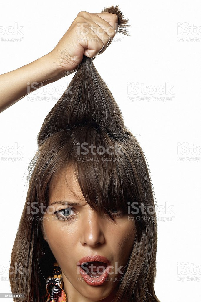 Hand holds woman's strong hair stock photo