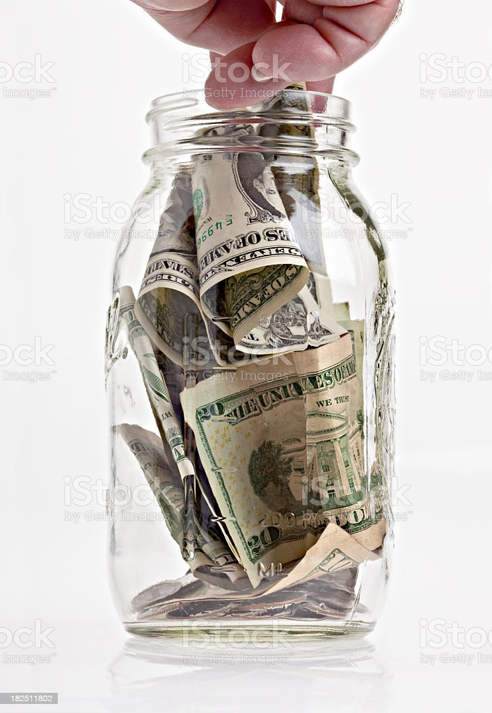 Hand In A Jar Of Money royalty-free stock photo