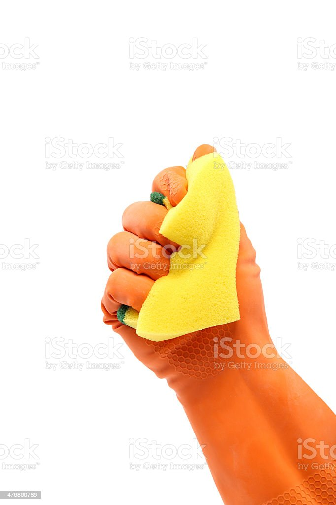 Hand in a rubber glove holding domestic sponge. stock photo