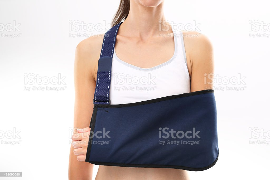 Hand in a sling stock photo