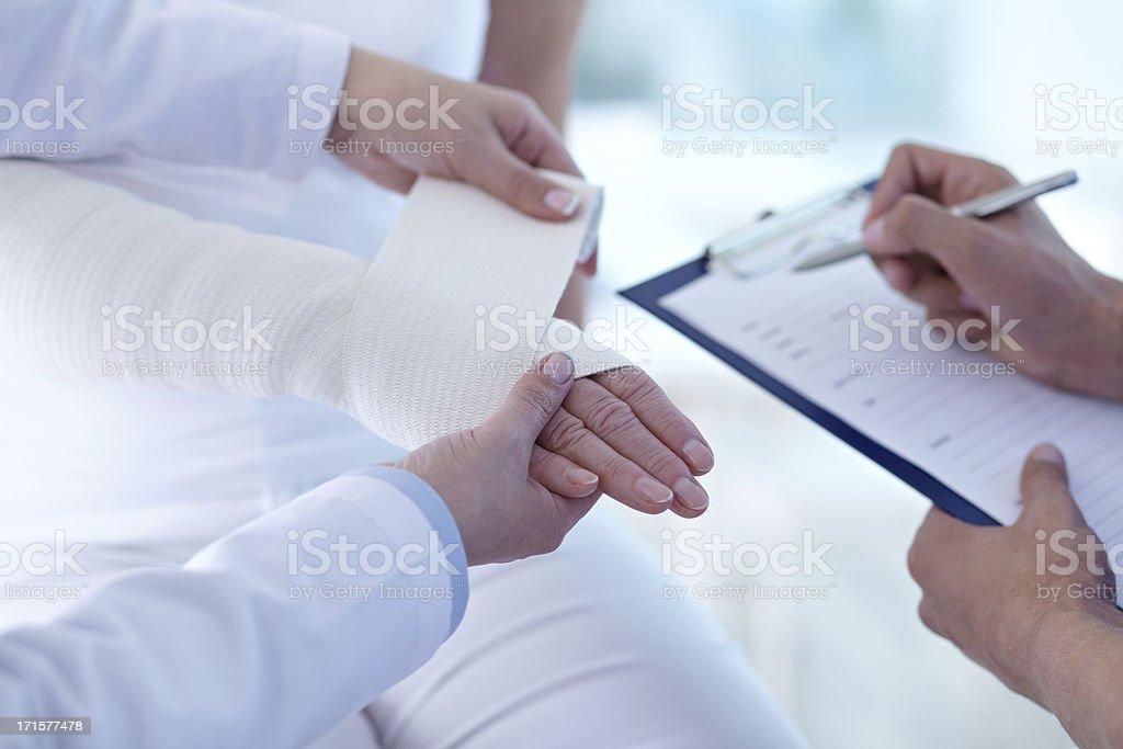 Hand in bandage stock photo