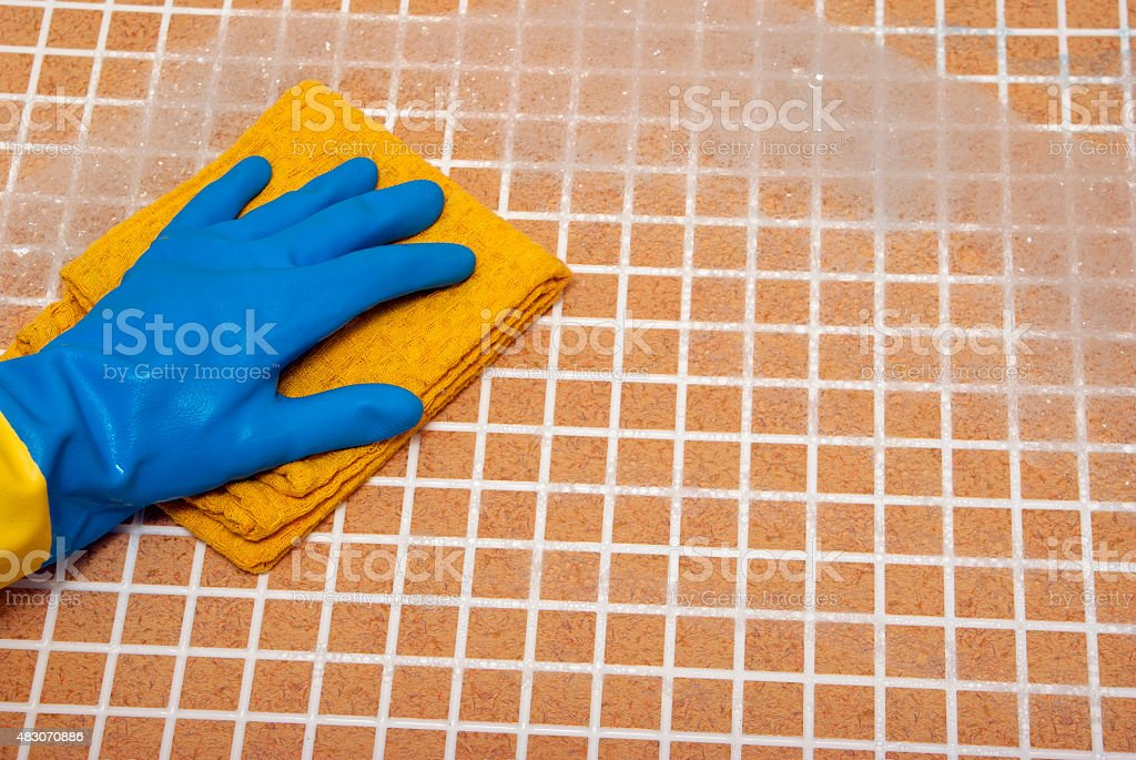Hand in blue glove royalty-free stock photo
