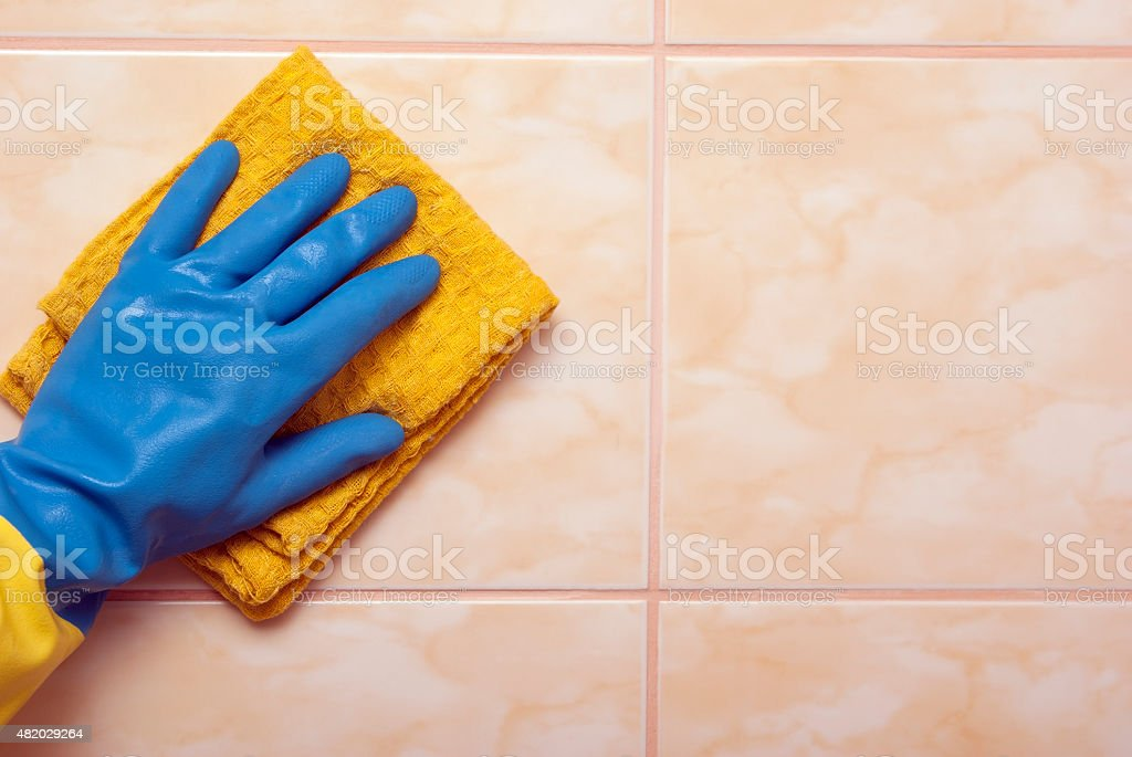 Hand in blue with yellow glove royalty-free stock photo
