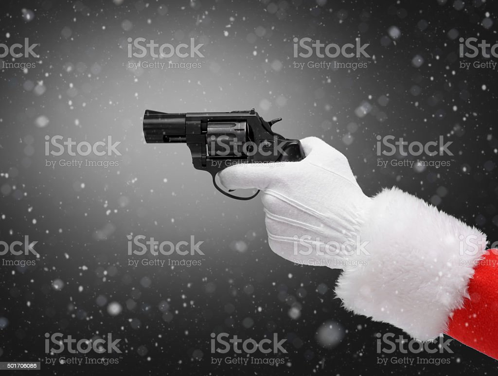 Hand in costume Santa Claus is holding gun stock photo