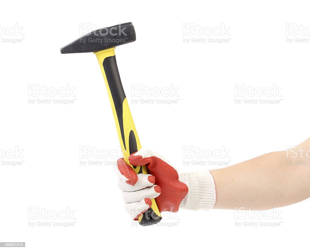 Hand in glove holding metal hammer. stock photo