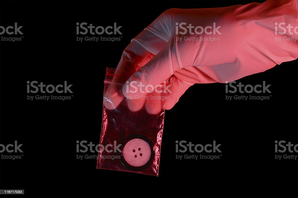 Hand in glove holding the evidence royalty-free stock photo