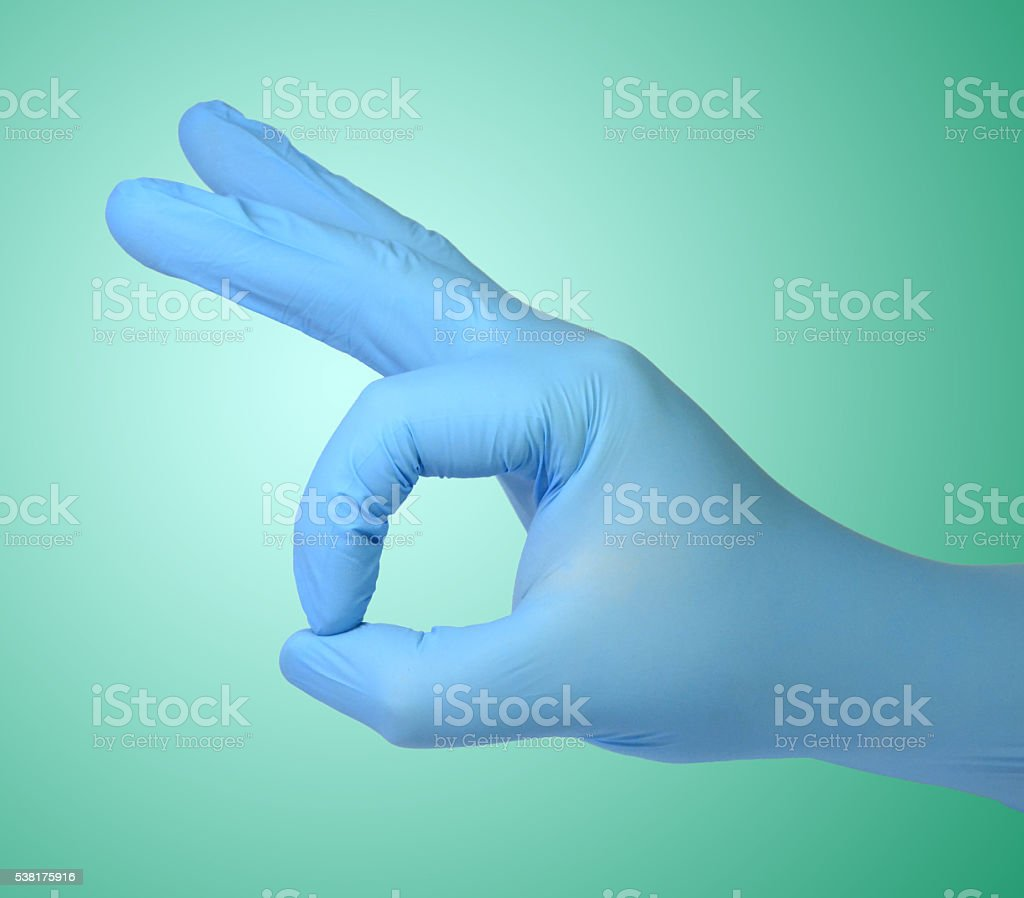 Hand in glove stock photo