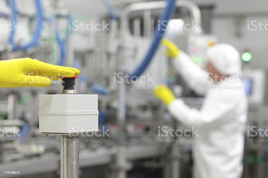 hand in glove pressing button - controling  industrial process stock photo