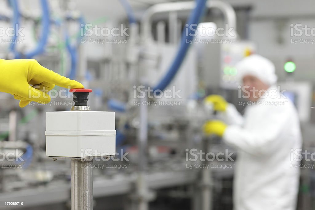 hand in glove pressing button - starting industrial process stock photo