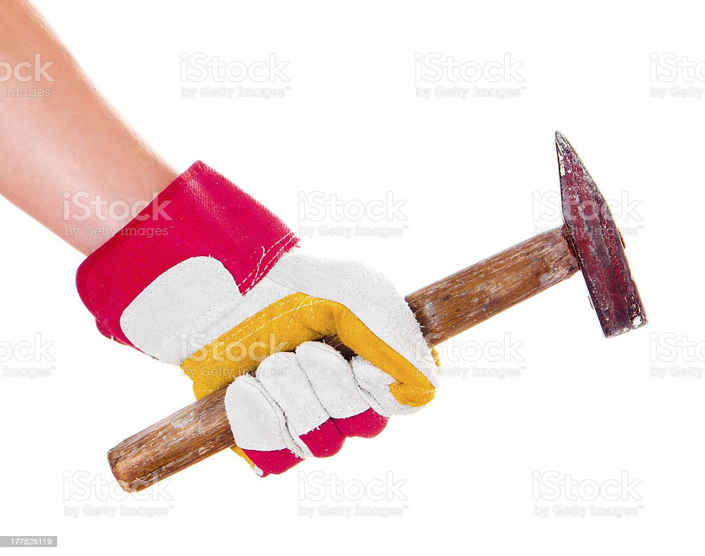 hand in glove with hammer royalty-free stock photo