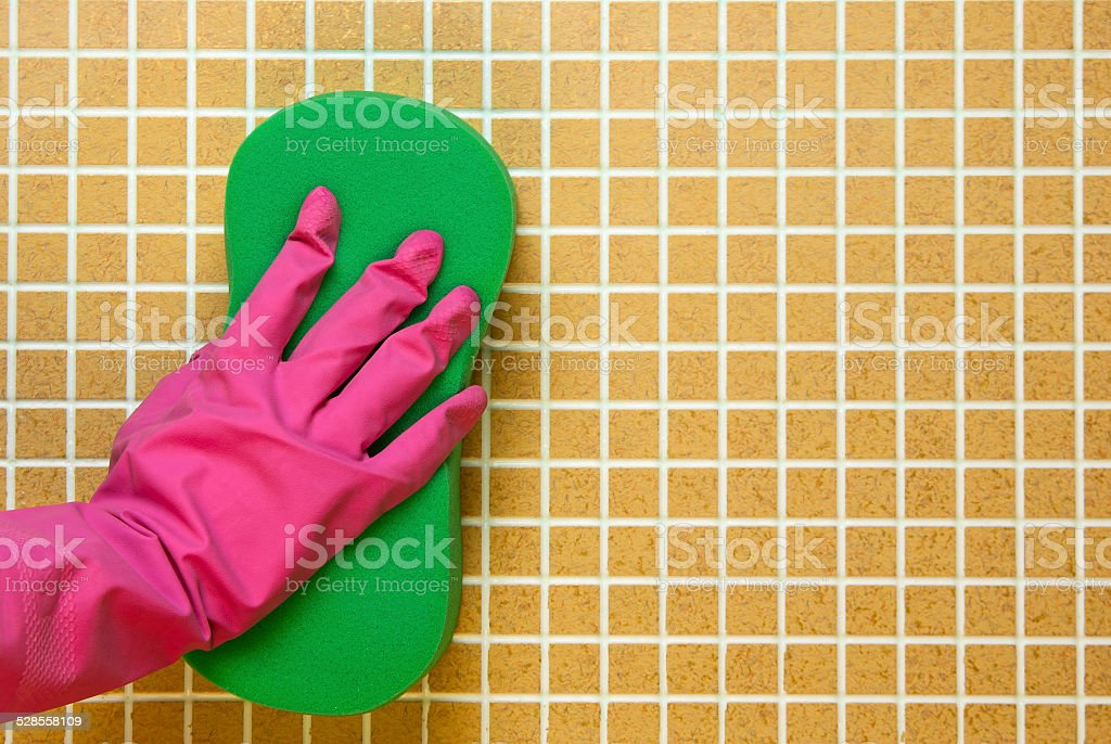Hand in glove with pink royalty-free stock photo