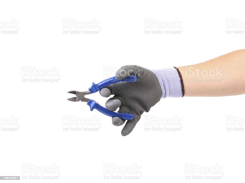Hand in gloves holding pliers. royalty-free stock photo