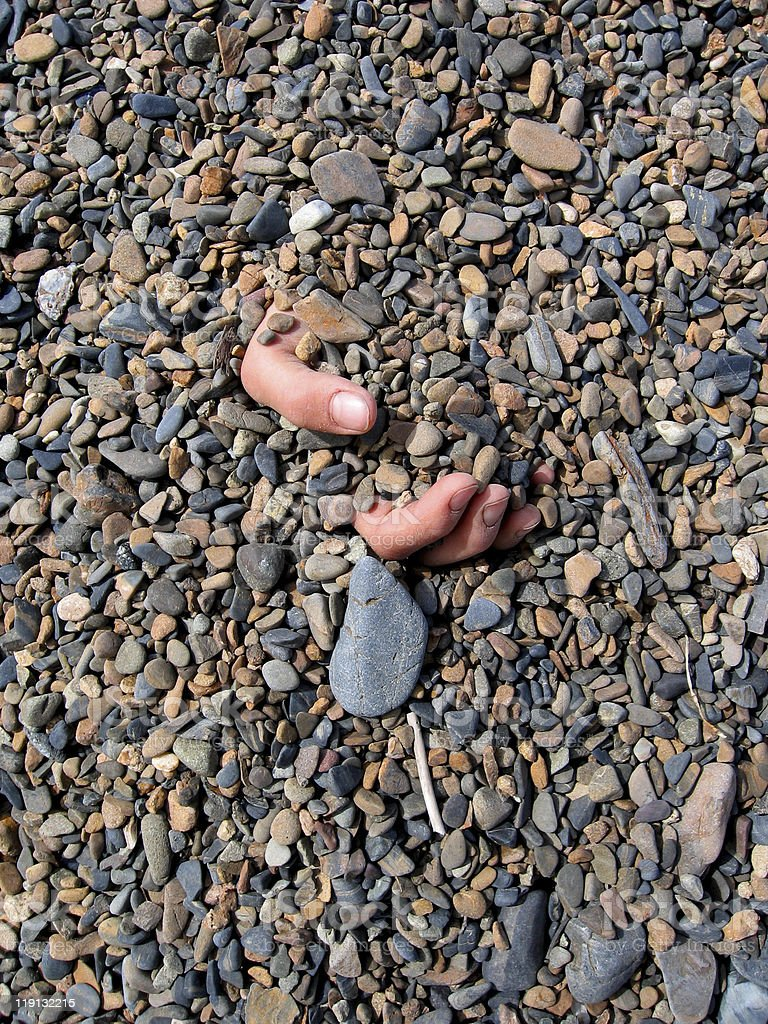 Hand in Gravel royalty-free stock photo