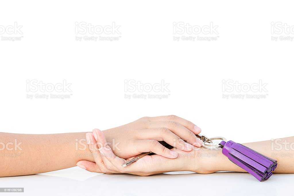 Hand in hand on the white table stock photo