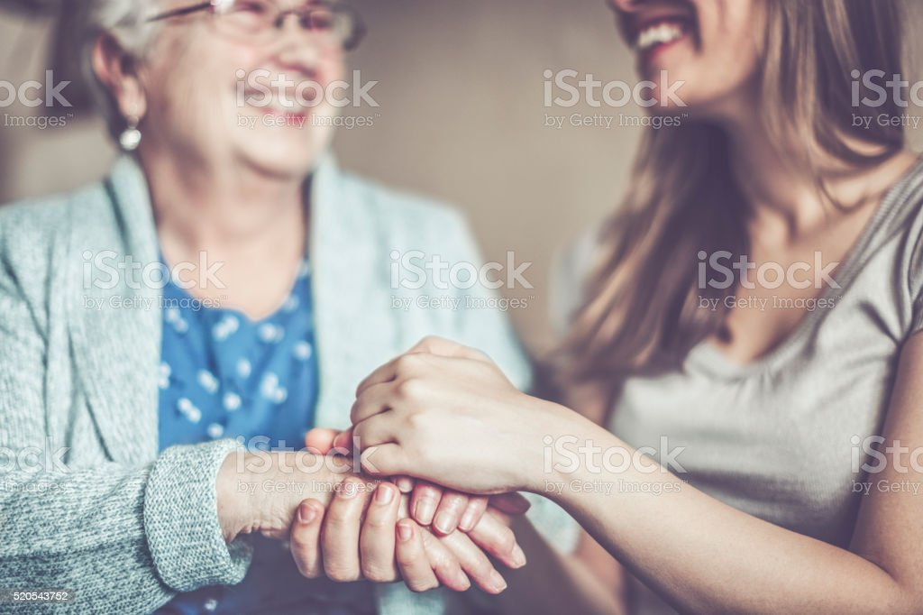 Hand in hand stock photo