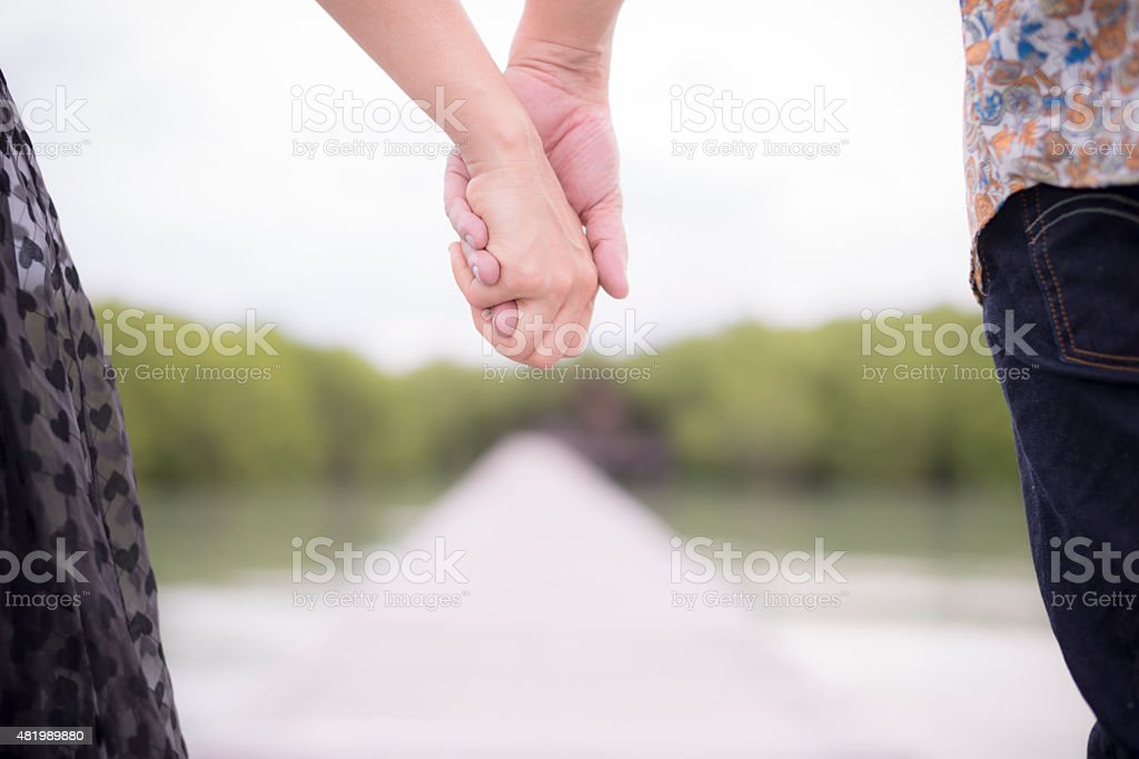 Hand in hand. Together on the way royalty-free stock photo