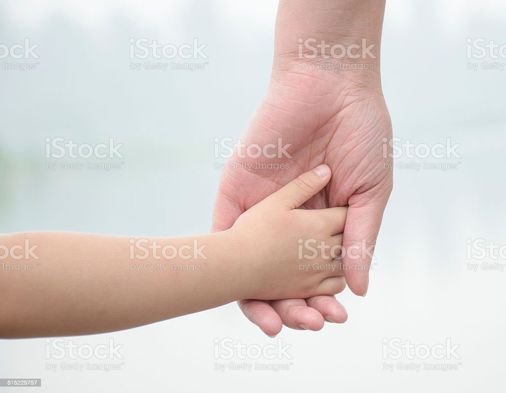 hand in hand,small hand in big hand stock photo