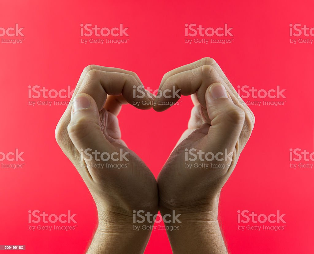 Hand in heart shape stock photo