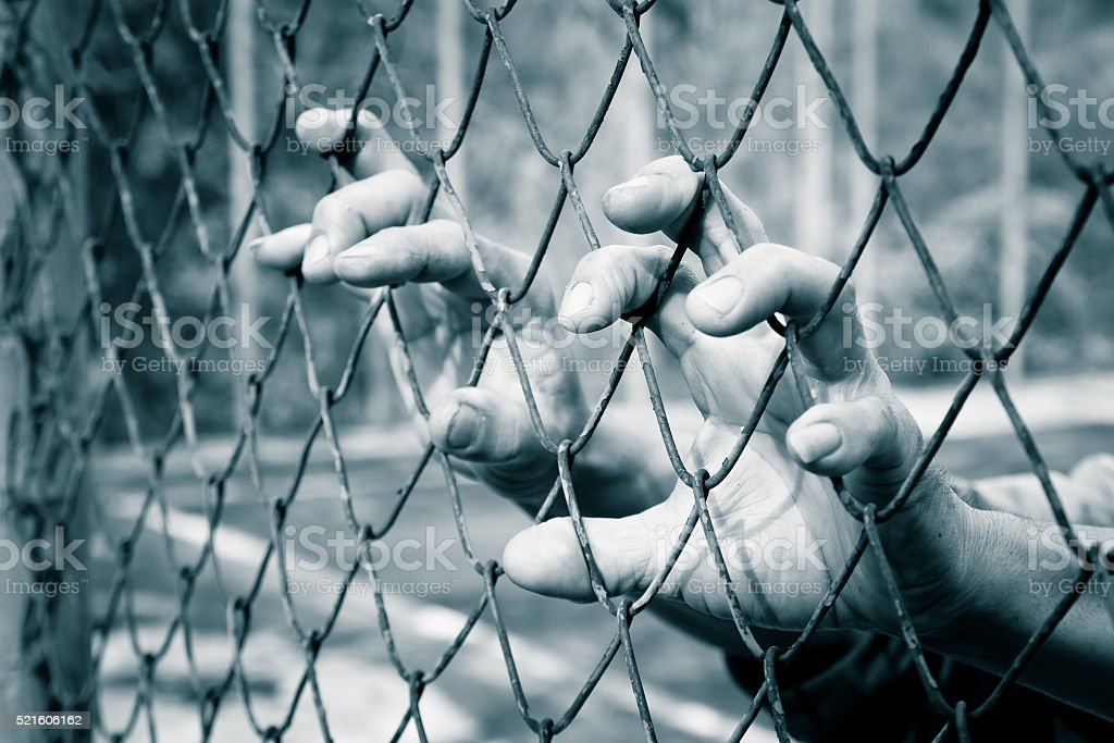 hand in jail ,retro tone stock photo