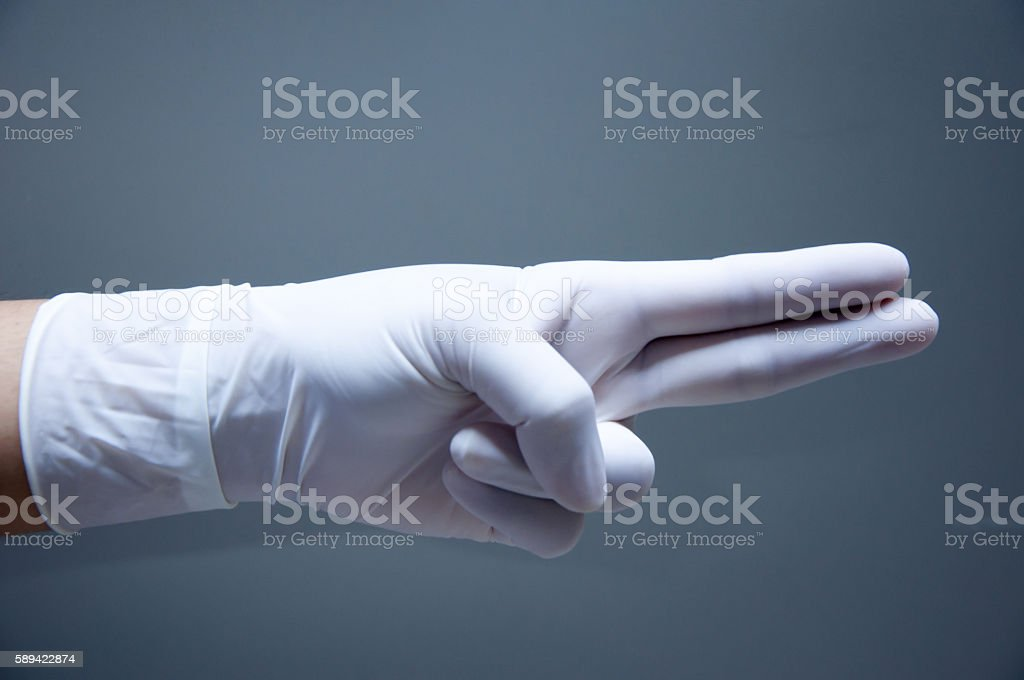 Hand in medical glove stock photo