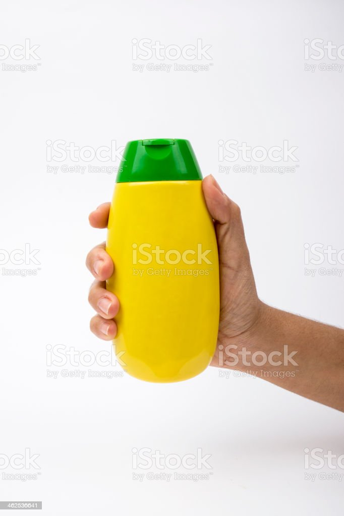 Hand in mustard bottle royalty-free stock photo