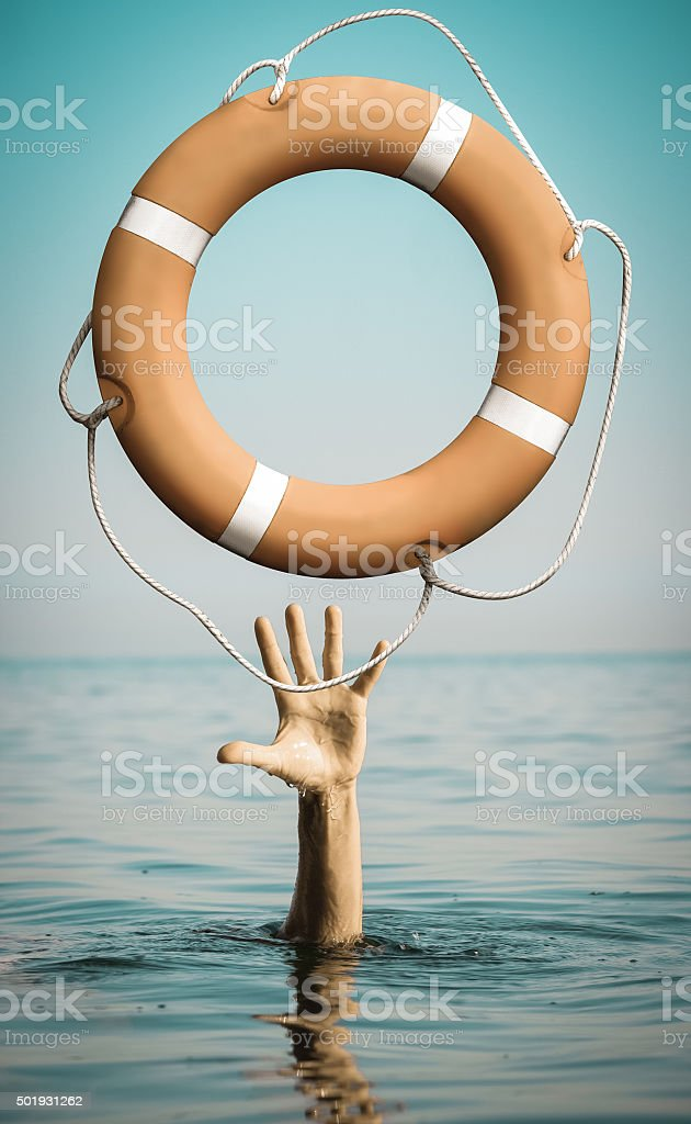 Hand in sea water with lifebuoy asking for help stock photo