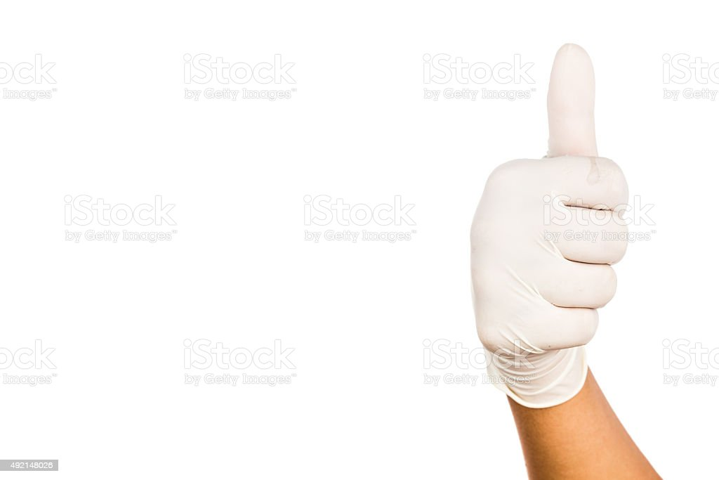 Hand in surgical latex glove gesture Thumbs up good stock photo