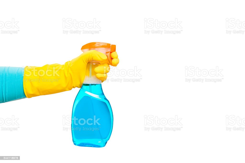 hand in yellow glove holding a spray for cleaning glasses stock photo