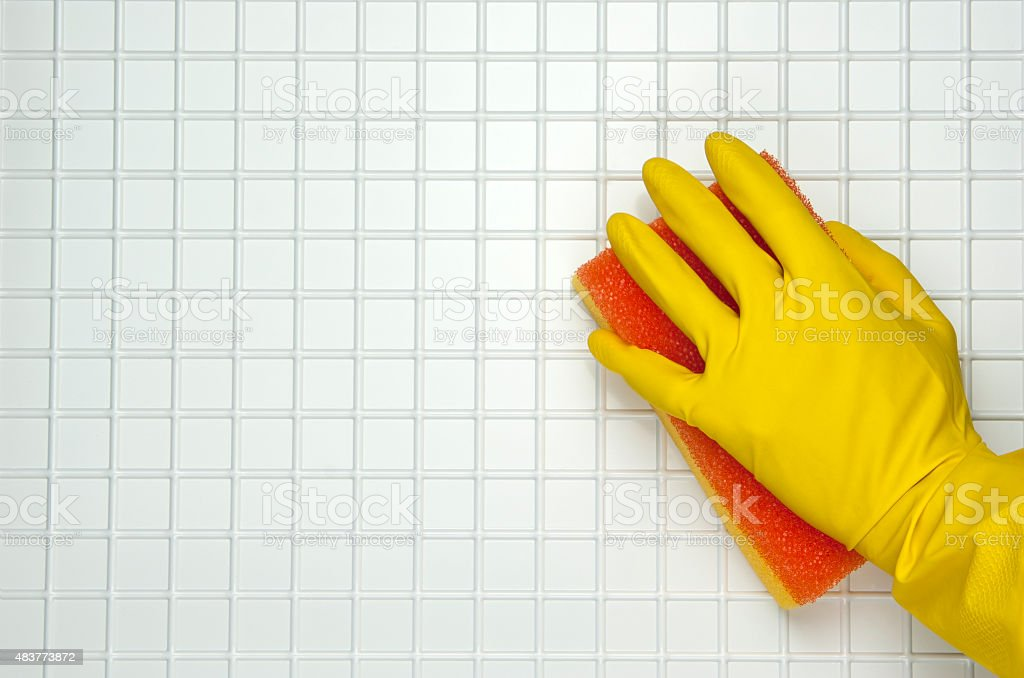 hand in yellow glove royalty-free stock photo