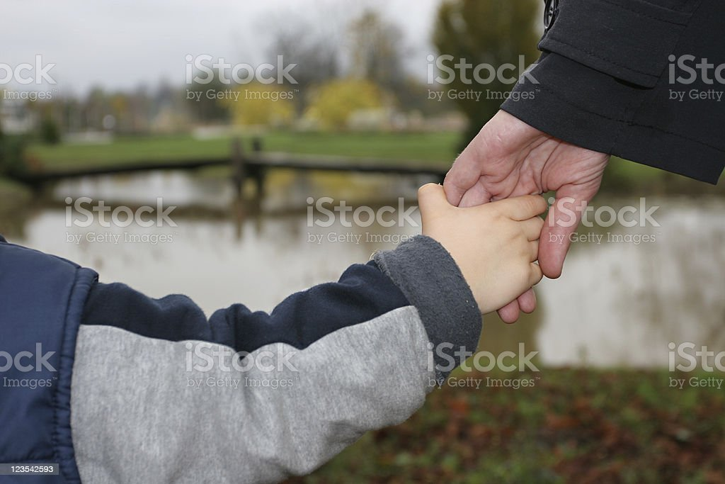 Hand in-hand royalty-free stock photo
