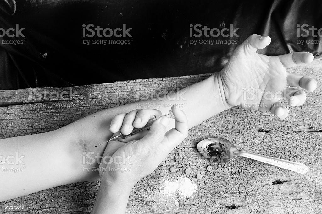 Hand injection drug  with old glass syringe blood, amphetamine t stock photo