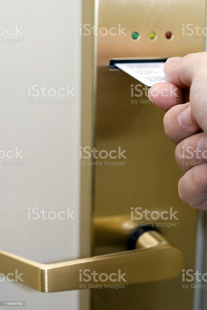 Hand Inserting Hotel Room Electronic Door Lock Keycard stock photo