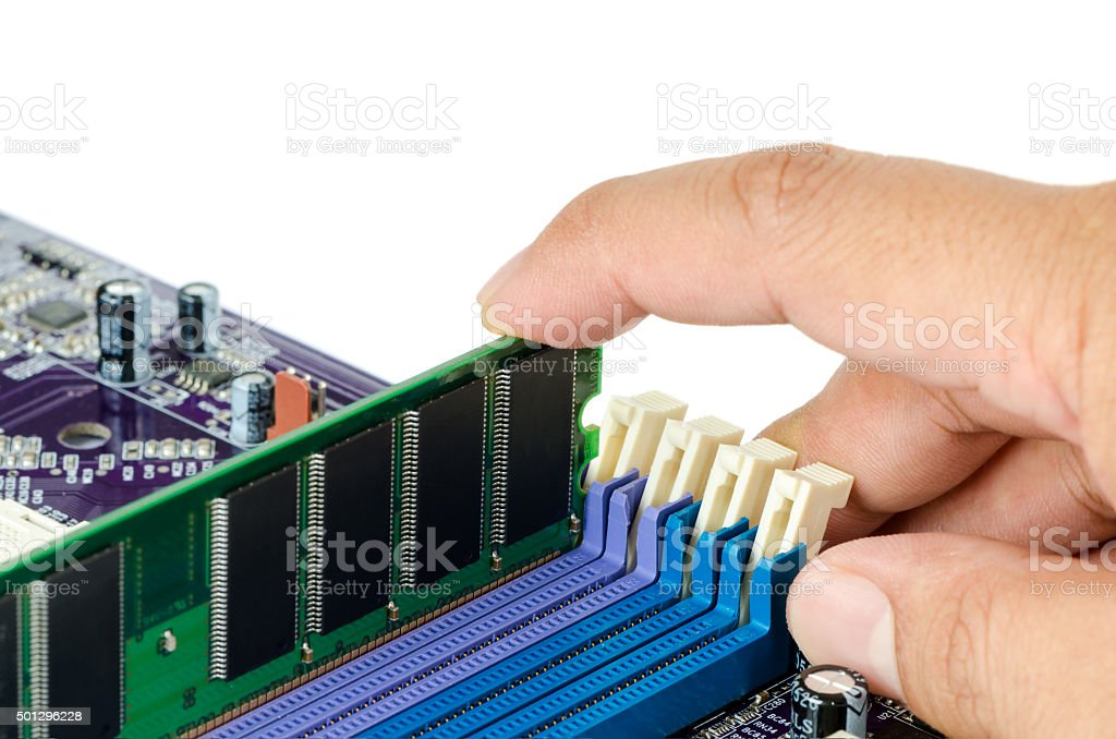 Hand installing Random Access Memory (RAM) into Motherboard stock photo