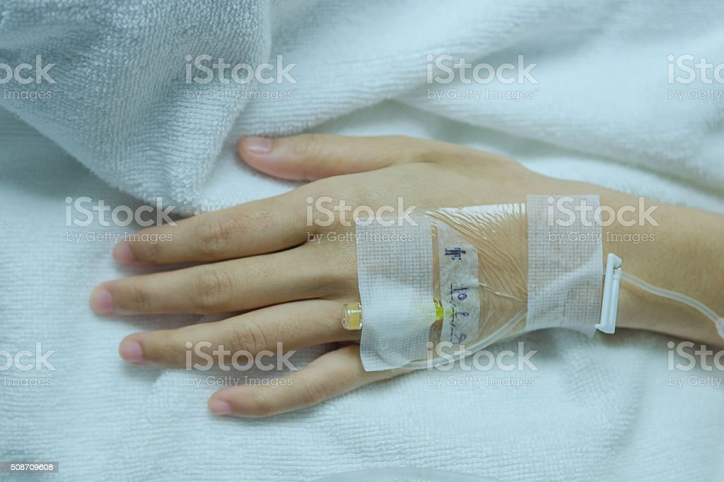 hand is a popular area of saline and intravenous medi stock photo