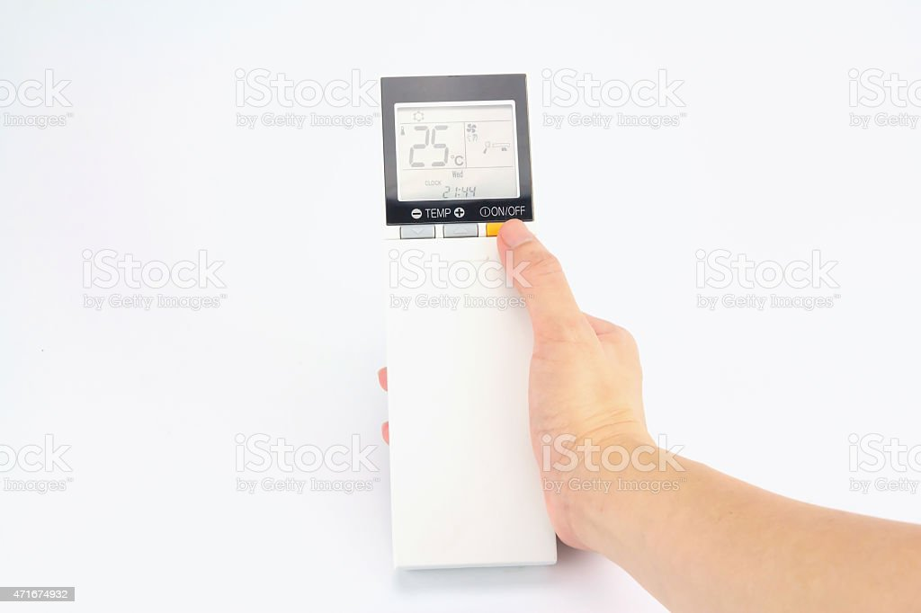 Hand is holding a remote control of air conditioner royalty-free stock photo