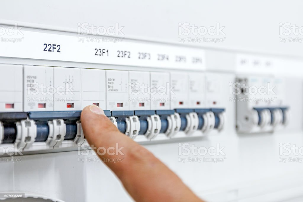 Hand is showing on electrical control panel electricity distribu stock photo