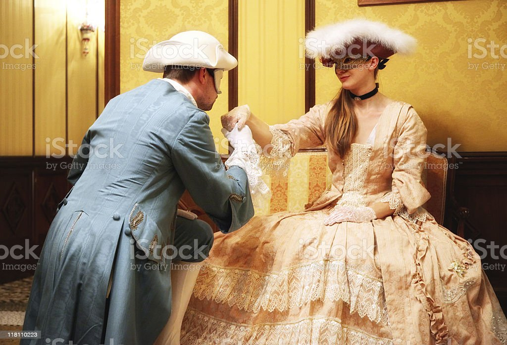 hand kissing baroque couple at venetian carnival stock photo