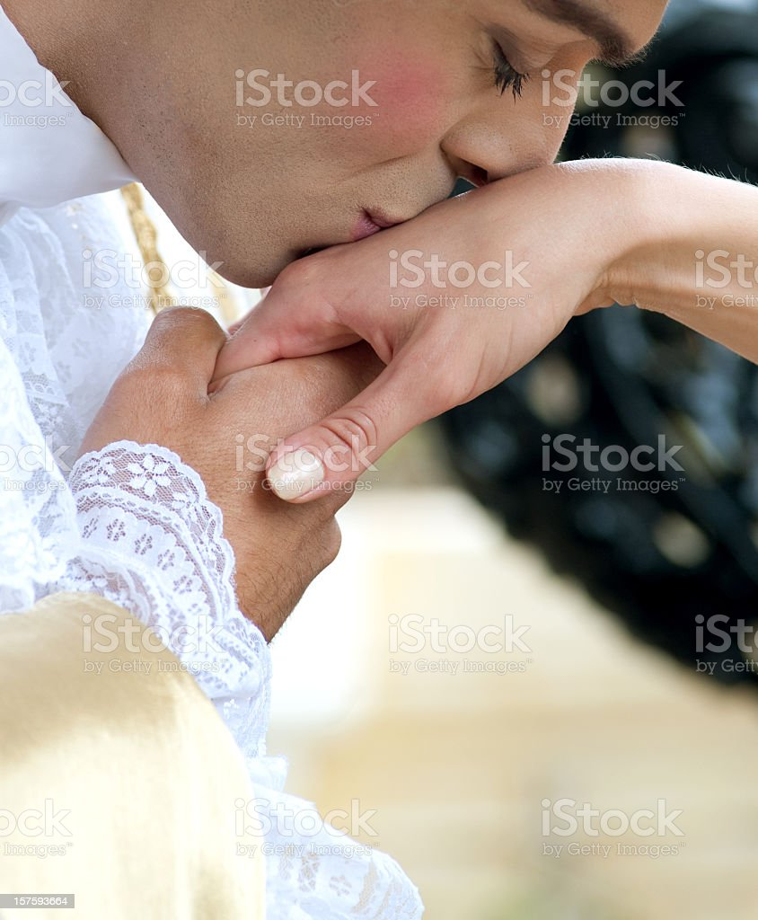 hand kissing baroque couple stock photo