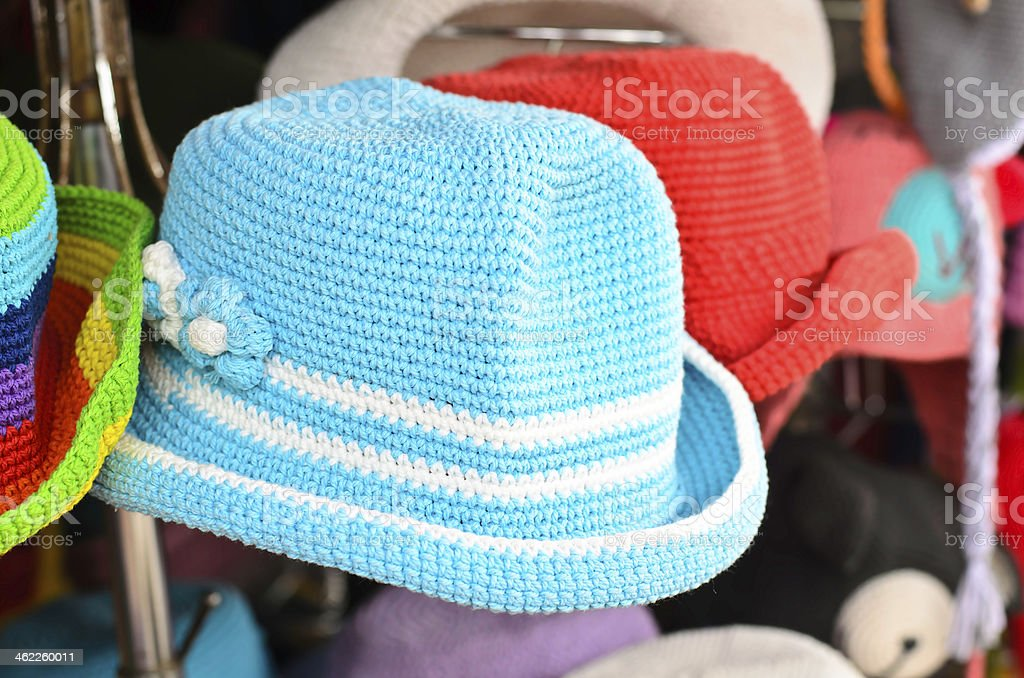 Hand knitted hats on  display for sale stock photo