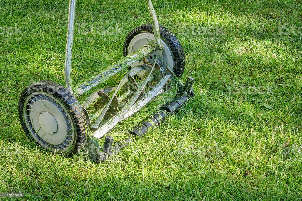 hand lawn mower close up stock photo